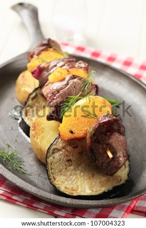 Beef shish kebab with roasted potato and aubergine
