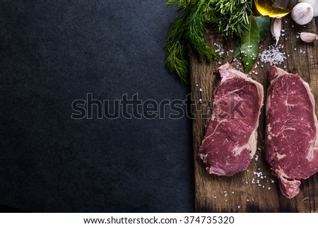 Beef sirloin steaks , on wooden board. Food border background, copy text space. - stock photo