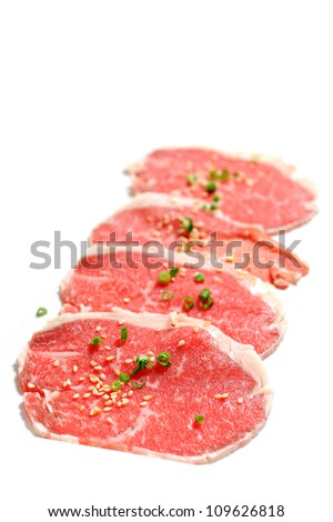 Beef slices isolated on white background with sesame and Onion - stock photo