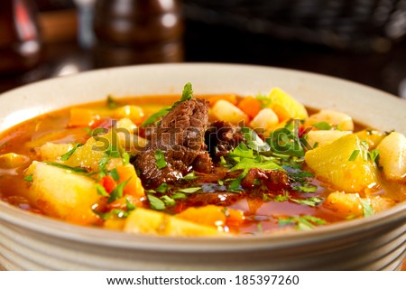 Beef soup with vegetables and parsley - stock photo