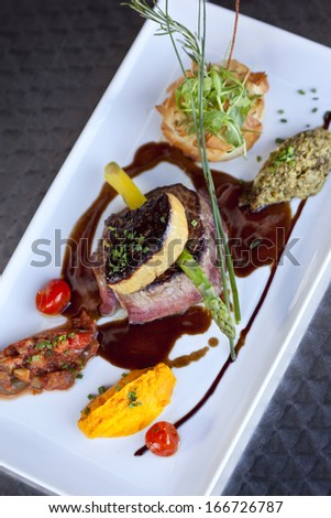 Beef steak and foie gras, vegetables and red wine sauce