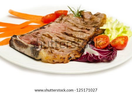 beef steak and vegetable garnish