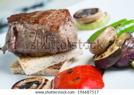 Beef steak and vegetable on plate