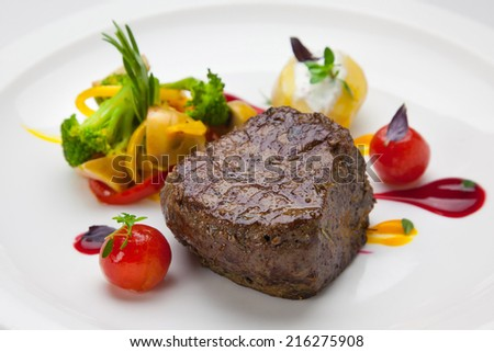 beef steak and vegetables on a plate - stock photo