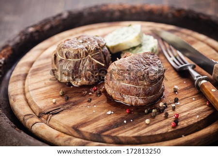 Beef steak filet mignon and butter with herbs - stock photo
