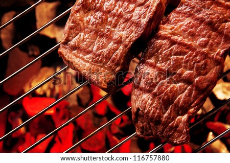 Beef steak meat on Barbecue grid - stock photo
