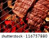 Beef steak meat on BBQ Barbecue grid. - stock photo