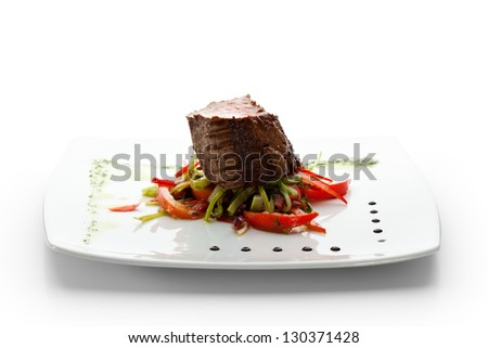 Beef Steak on Fresh Salad Leaf with Pesto Sauce - stock photo
