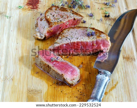 beef steak rare on the wooden cutting board - stock photo