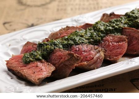 beef steak wit chimichurri sauce - stock photo