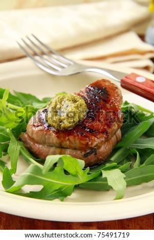 beef steak with arugula salad and pesto - stock photo