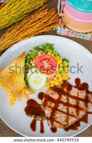 Beef steak with black pepper sauce , salad and French fries on sack background - stock photo