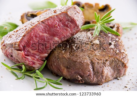 beef steak with herbs - stock photo