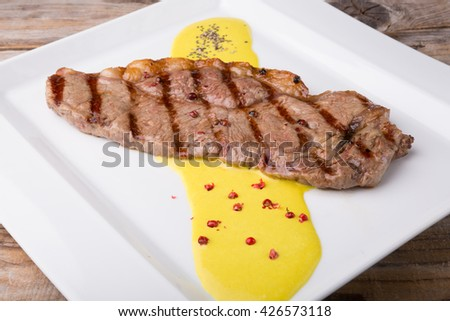 Beef steak with mushroom sauce and pepper seasoning - stock photo