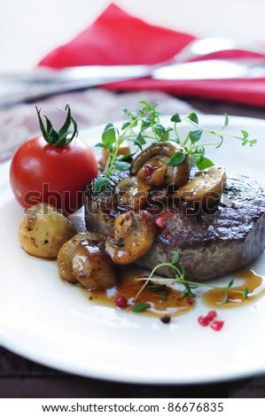 beef steak with mushrooms - stock photo