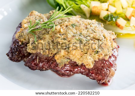 Beef steak with mustard herb crust and romaine lettuce hearts with ...