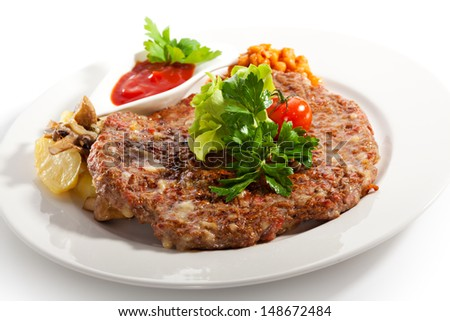 Beef Steak with Onion, Garlic, Cheese and Bacon. Garnished with Potato and Spicy Sauce - stock photo