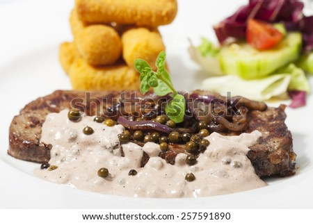 beef steak with pepper sauce  - stock photo