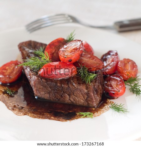 Beef steak with roasted tomato, selective focus