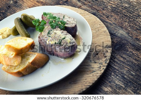 Beef steak with rosemary, baguette, dijon mustard and pickle