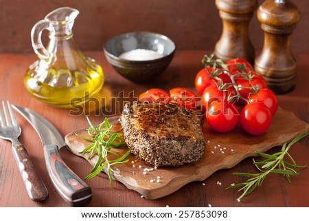 beef steak with spices and rosemary on wooden background - stock photo
