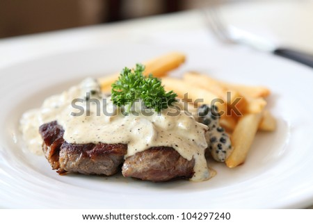 Beef steak with white sauce - stock photo