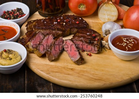Beef Steaks with Sauces, French Fries and Vegetables - stock photo