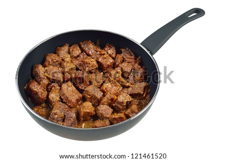 Beef stew in a frying pan. Isolated on white. - stock photo