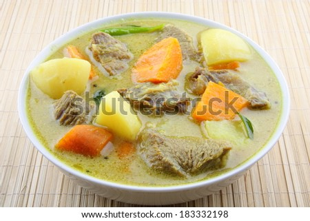 Beef stew simmering and ready to serve.  - stock photo