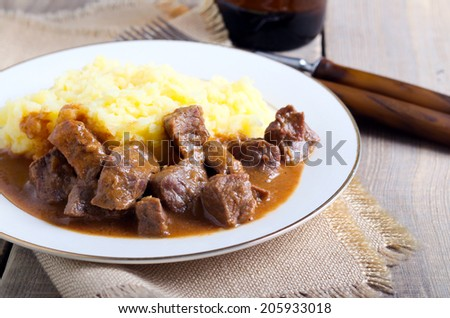 Beef stew with gravy and mashed potato