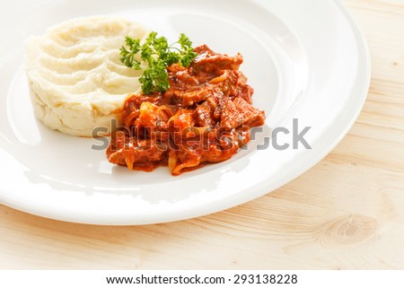 Beef stew with mashed potatoes - stock photo
