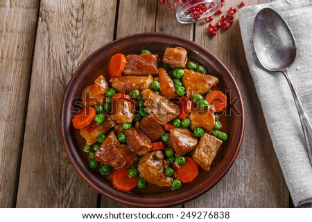 beef stew with peas and carrot - stock photo