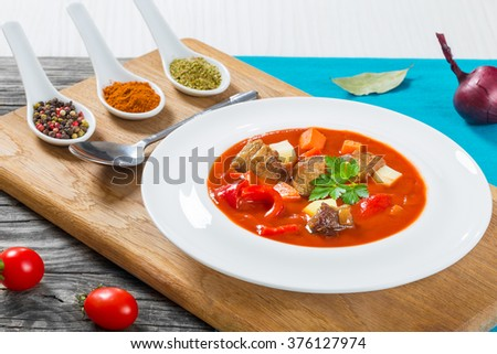 Beef stew with potato, sweet pepper, onion, carrot and spices, traditional hungarian soup, closeup - stock photo