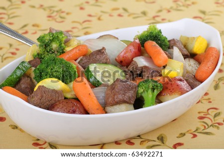 Beef stew with vegetables in a serving bowl