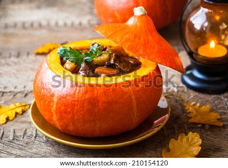Beef stew with vegetables  in pumpkin - stock photo