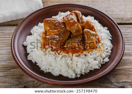 beef stew with white rice and sauce - stock photo