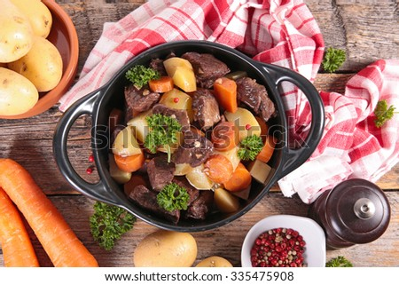 beef stew with wine sauce and vegetables - stock photo