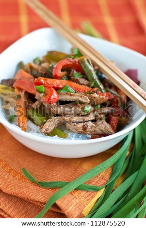 Beef stir-fry with vegetable over  rice - stock photo