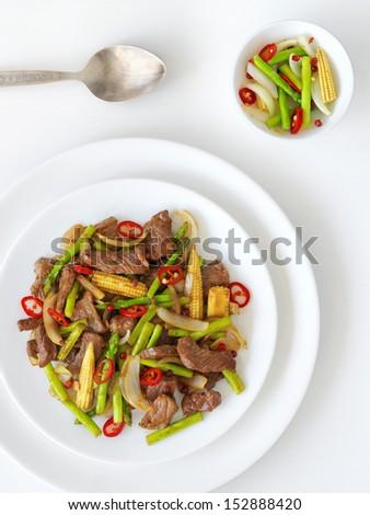 Beef stirfry, studio shot - stock photo