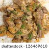 Beef stroganoff served with rice. - stock photo