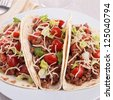 beef tacos with salad and tomato - stock photo