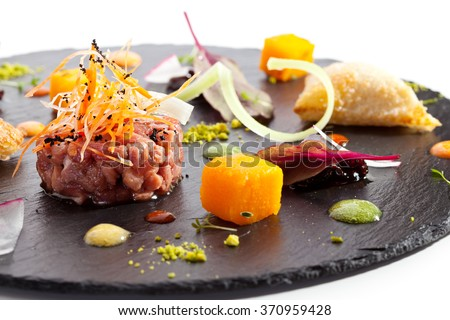Beef Tartare on Black Stone - stock photo