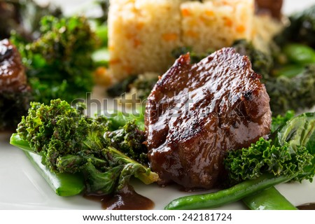 beef tenderloin medallions - stock photo
