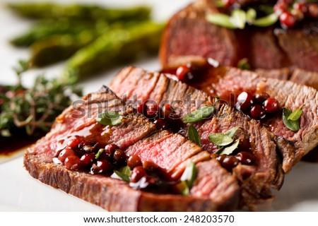 Beef tenderloin sliced - stock photo