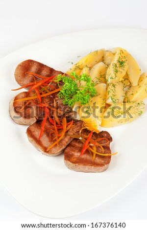 beef tongue with potatoes, carrots and greenery
