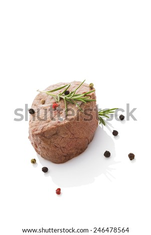 Beefsteak isolated on white background with colorul peppercorn. Culinary red meat eating.  - stock photo