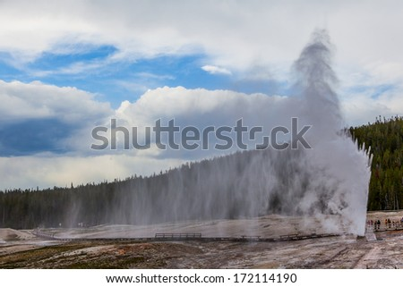 Beehive geyser Eruption, Yellowstone National Park, Wyoming - stock photo