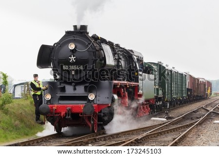 BEEKBERGEN, NETHERLANDS - MAY 19 , 2013: steam train from the Veluwsche steam train company  is driving into the historic railway station in Beekbergen in the Netherlands.
