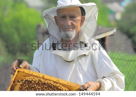 beekeeper, honey gathering - stock photo