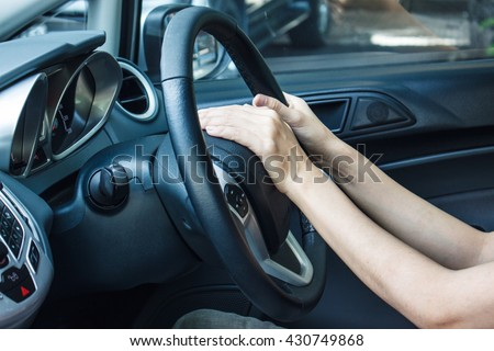 Beeping car driver, woman in luxury car